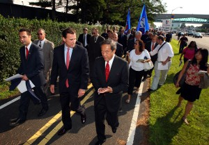 """Charles Wang and Tom Suozzi march in the """"Just Build It"""" rally"""