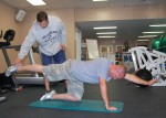 Islesblogger stretching on yoga mat